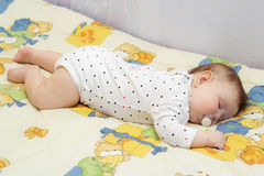 Little newborn baby girl sleeping. On a big bed Royalty Free Stock Photo