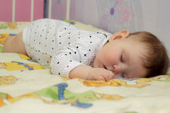 Little newborn baby girl sleeping Stock Images
