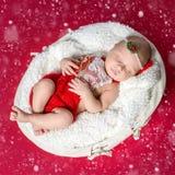 Little newborn baby in red costume sleeping Stock Photo