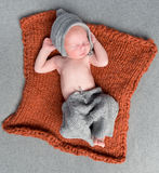 Little newborn baby sleeping on knitted blanket Royalty Free Stock Photo