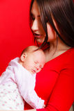 Little newborn baby sleeping on mother chest Stock Images