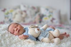 Little newborn baby sleeping, baby with scin rash. Little newborn baby sleeping with toy, baby with scin rash, child dermatitis symptom problem rash, newborn Royalty Free Stock Images