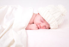 Little Newborn Baby Sleeping on White with Blanket stock photography
