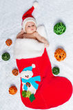 Little newborn  St. Nicholas in New Year's bootee.  Stock Photography