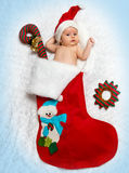 Little newborn  St. Nicholas in New Year's bootee.  Stock Photo