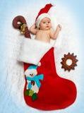 Little newborn  St. Nicholas in New Year's bootee Stock Photo