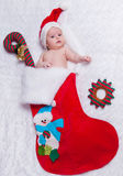Little newborn  St. Nicholas in New Year's bootee Stock Image