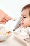 Little nice girl feeding Royalty Free Stock Photos