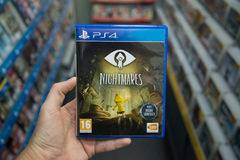 Little Nightmares. Bratislava, Slovakia, circa april 2017: Man holding Little Nightmares videogame on Sony Playstation 4 console in store Royalty Free Stock Images