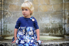 Little not smiling girl. Little smiling girl in the park Stock Photo