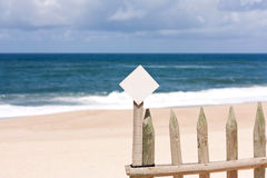 Little Notice board on the beach Royalty Free Stock Photo