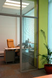 Little office study behind the partition. Little office study behind the glass partition stock photography