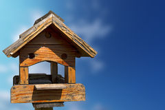 Little Old Birdhouse on Blue Sky Stock Images
