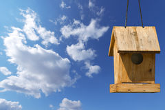 Little Old Birdhouse on Blue Sky Stock Image