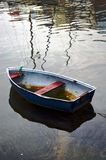 Little old boat on oily water Stock Images