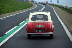 Little old car on highway in the Netherlands Royalty Free Stock Photography