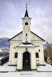Little old church in the Austrian Alps. A little old chapel with the Austrian Alps in the background Royalty Free Stock Photography
