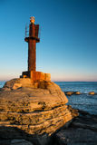 A little old lighthouse. Landscape with an old lighthouse and sea Royalty Free Stock Photo
