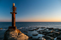A little old lighthouse. Landscape with an old lighthouse and sea Royalty Free Stock Image