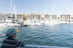 Little boy in the Old Port of Marseille Stock Photo