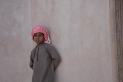 Little omani boy on a wall Stock Photo