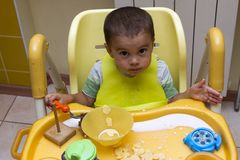 Incredible Little One Year Old Kid Eats Porridge While Sitting In His Short Links Chair Design For Home Short Linksinfo
