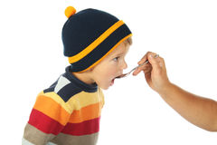 Little open-mouthed boy with spoon Royalty Free Stock Image
