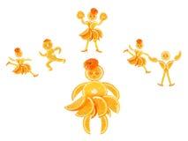 Little orange imagines himself a dancer and an athlete. Fat little orange imagines himself a dancer and an athlete royalty free stock images