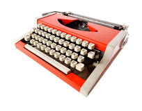 Little orange typewriter. Isolated objects: little orange typewriter, wide angle shot, on white background Stock Photo