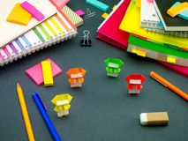 Little Origami Ninjas Helping Your Work on Your Desk When You Ar Royalty Free Stock Photos