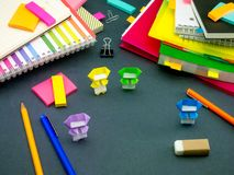 Little Origami Ninjas Helping Your Work on Your Desk When You Ar Stock Photos