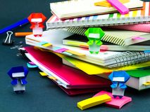 Little Origami Ninjas Helping Your Work on Your Desk When You Ar Royalty Free Stock Photo