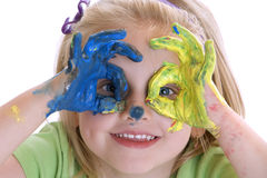 The little Painter. Smiling child with colored hands after painting session Stock Photo