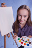 Little painter. And easel and brushes Stock Images