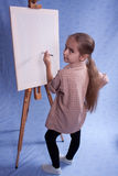 Little painter. Stay near easel Royalty Free Stock Image