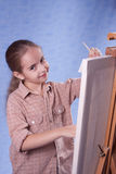 Little painter. At the work Royalty Free Stock Photo
