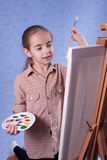 Little painter. At the work Royalty Free Stock Photos