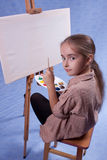 Little painter. At the work Royalty Free Stock Images