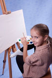 Little painter. At the work Royalty Free Stock Photography