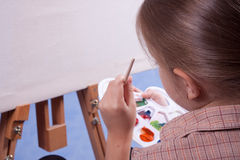 Little painter. At the work Stock Image