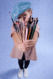 Little painter. And set of brushes Royalty Free Stock Images