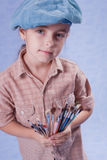 Little painter. And set of brushes Stock Photos