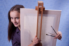 Little painter. Behind the easel Royalty Free Stock Photography