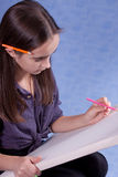 Little painter. Drawing with pencils Royalty Free Stock Photos