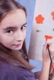 Little painter. Has paint flowers Stock Images