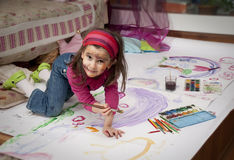 Little painter. Little girl painting at home with water colors stock image