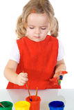 Little painter girl absorbed by the work Stock Images