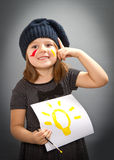 Little painter girl with an idea Royalty Free Stock Image