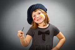 Little painter girl isolated on grey Stock Photos
