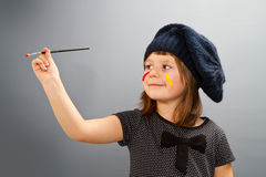 Little painter girl isolated on grey Stock Photography